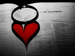 Heart shaped shadow cast by a ring on Bible (S...