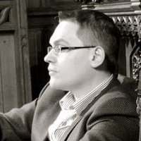 English: Photograph of British composer Paul M...