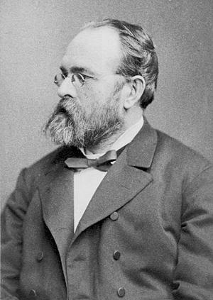 English: German composer Josef Gabriel Rheinbe...